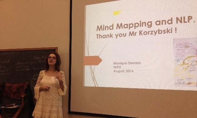Picture of Monique Demers introducing NLP Heuristic map